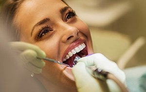 Woman receiving tooth contouring