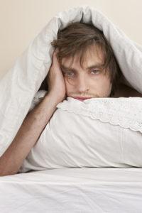 sleeping man frustrated