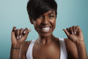 woman knows why flossing is important