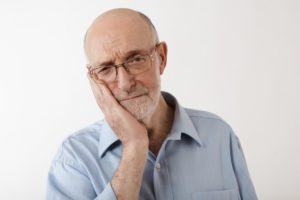 the dangers of getting dental implants for cheap